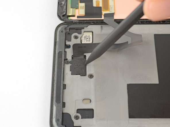 Insert the point of a spudger into the small hole on the edge of the display connector cover.