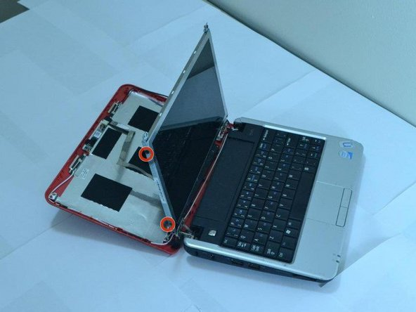 Pull down the laptop's back; keeping the screen upright, held in place by two metal strips going along its sides.