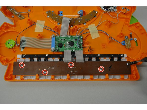 Near the bottom of the device, unscrew 5 PH2 screws (7 mm) on the electric board.