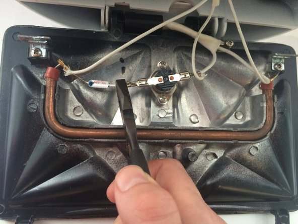 Align the thermal fuse with the open wires.