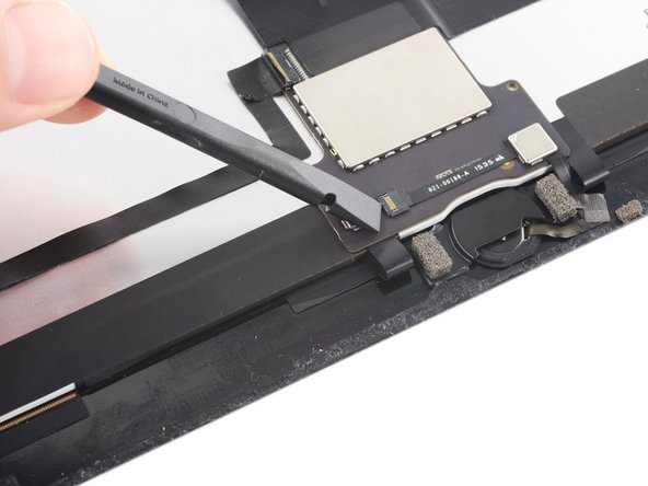 Use the flat edge of a spudger to lift the flap on the connector that secures the cable.