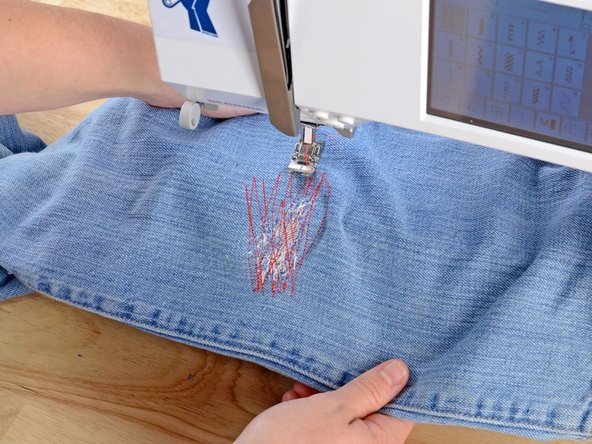 When you are satisfied with your stitching, backstitch two or three stitches.