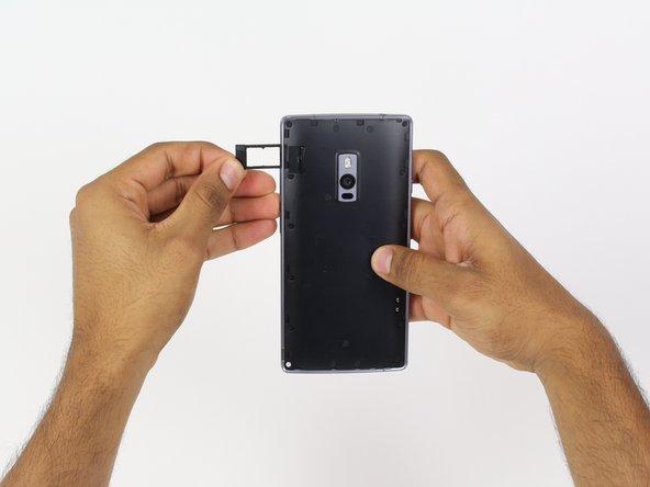 Remove the SIM card tray