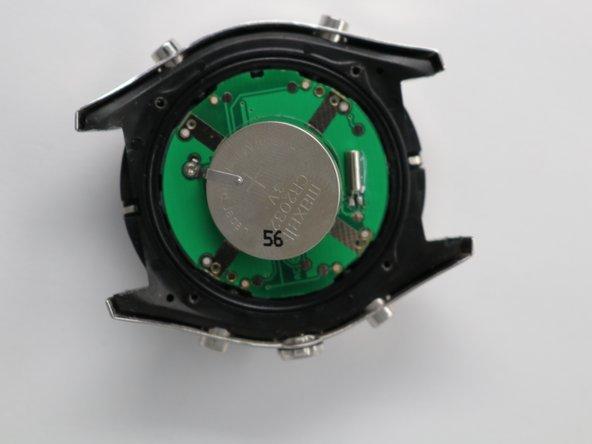 Remove the large circular Analog battery.