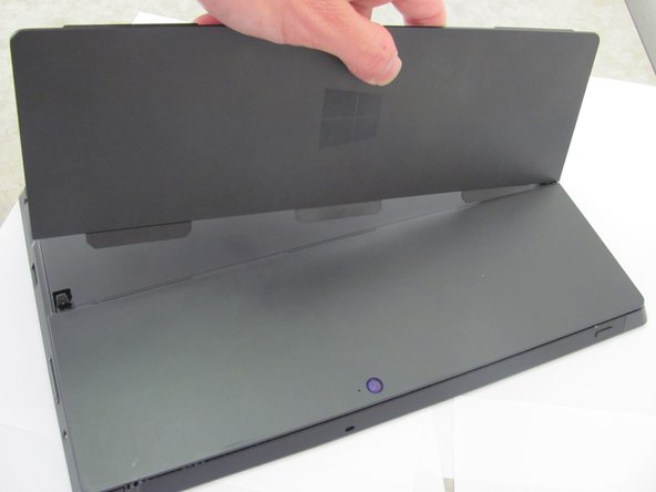 To remove the kickstand, gently pull up until the three tabs slide out of the slots on the back of the device.