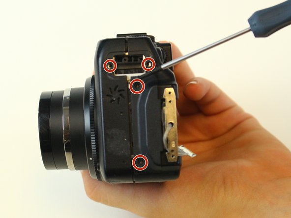 Remove all of the screws on both the left and right side of the camera.