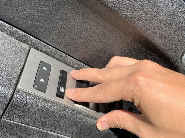 Push the re-assembled switch panel down until you hear a click, this means it is secure in the door.