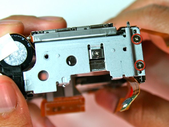 After completing the removal of the motherboard, remove the tripod mounting screws (3.4mm) on the left side