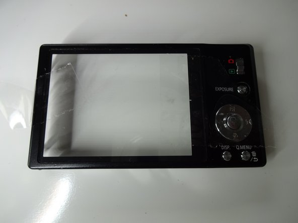 If your new LCD does not come with a window plate:  Tape your old window plate in place as shown in the photo. Make sure it lines up properly and fits into the grooves.  This makes re-assembly much easier.