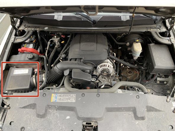 The airbox is located in the front left corner of the engine bay.