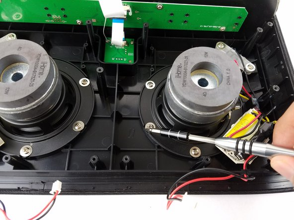 Remove the six 11 mm Philips #1 screws from the perimeter of the woofer.