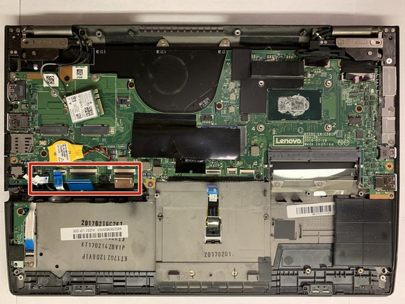 Pull up the 6 colored tabs along the edge of the motherboard to disconnect them from the motherboard.