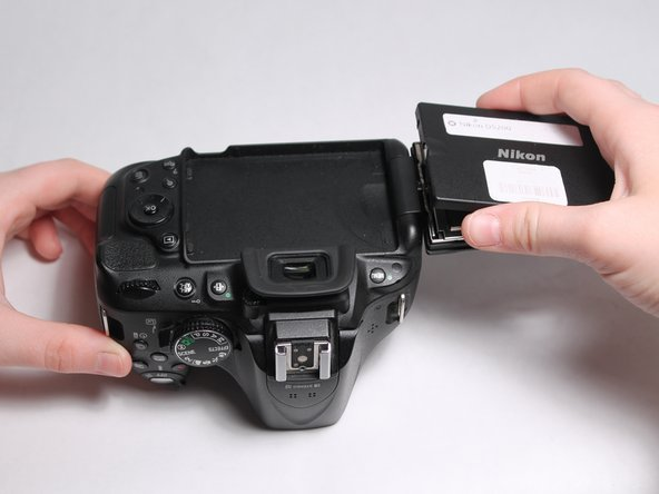 Pry open the plastic casing using the opening tool or by hand.