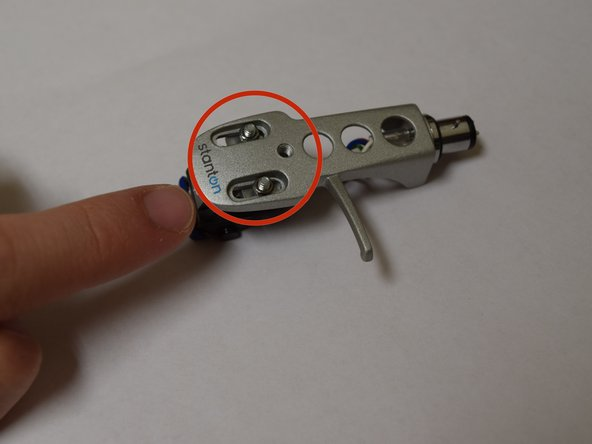 Remove screws with phillips screwdriver #0 to release the cartridge.