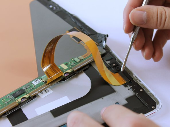Remove the ribbon cable using the Metal Spudger.