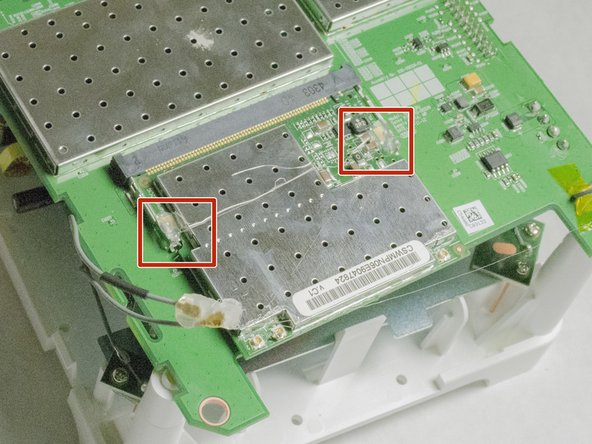 Remove the two pieces of glue holding the WIFI card in place.