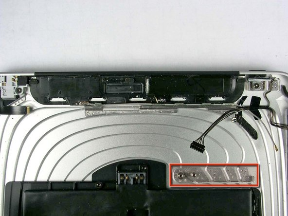 The iPad 3G has a black plastic strip along the top edge of the rear case for transmission of signals. The large black plastic piece at the top of this picture is the 3G antenna assembly.