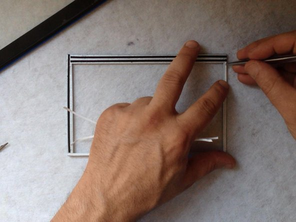 Again use a double side adhesive tape to install the the metal LCD frame.