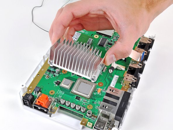 Lift the heat sink off the motherboard.