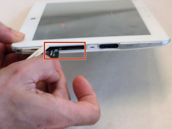 Pull the sim card out of the slot.