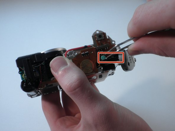 With tweezers, carefully unplug the two small wires from the green plug.