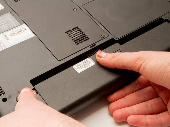 Rotate the laptop 180 degrees so that the battery is near you.