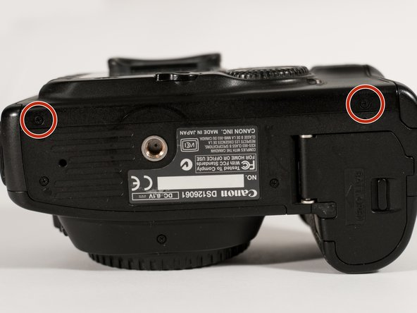 Remove both labeled screws from the bottom of the camera.