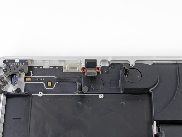 Remove the two 3.6 mm T5 Torx screws securing the headphone jack to the upper case assembly.