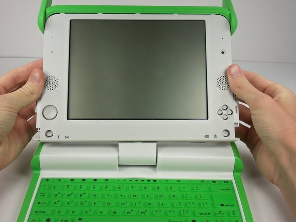 Pull down on the white screen cover. It does not require much force.