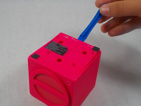 Using the plastic opening tool, insert  into the crack between the base plate and the main body of the device