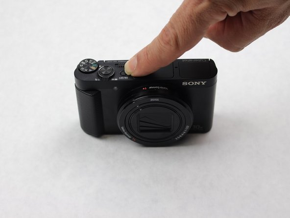 Before disassembling any part of the camera, turn off the power by pressing down on the ON/OFF button. The ON/OFF button is located on top of the camera.