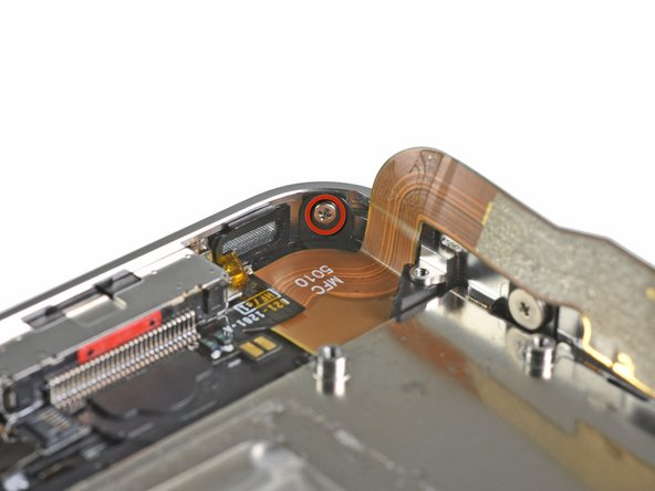 Remove the 1.6 mm Phillips screw near the dock connector cable.