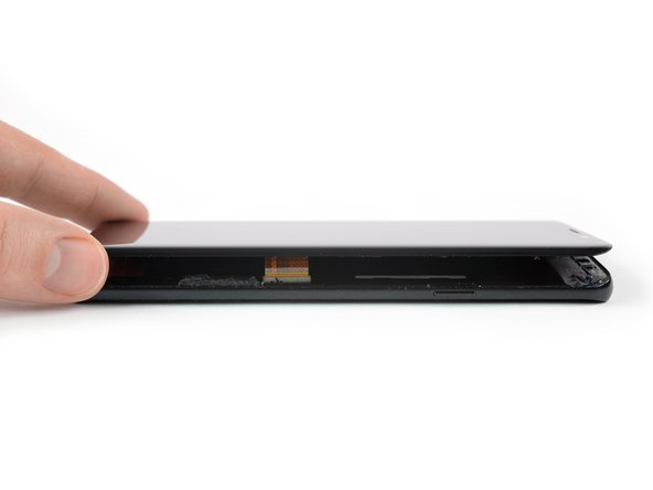Once you cut the adhesive on all sides of the phone you can slowly lift the display upwards and remove it.