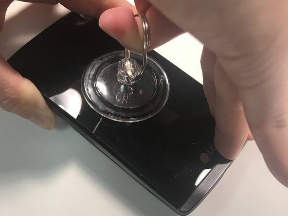 Once the iOpener has sat on the screen for about 5 minutes, use the suction cup to pull the screen apart from the rest of the fixture.