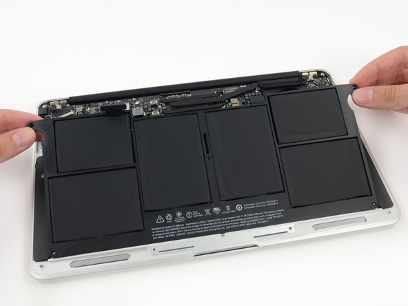 When handling the battery, avoid squeezing or touching the six exposed lithium polymer cells.