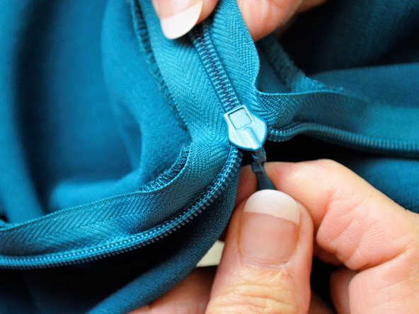Start zipping up the zipper to make sure it has been aligned properly.