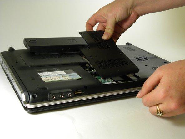 Remove the memory module compartment cover.