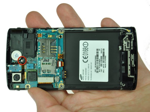 Use the Phillips 00 screwdriver to remove the single screw holding the speaker assembly to the LCD.