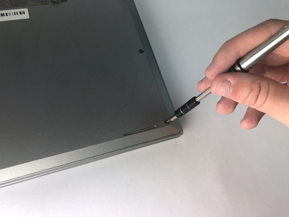 Remove the nine 7.6 mm PH0 screws on the cover.