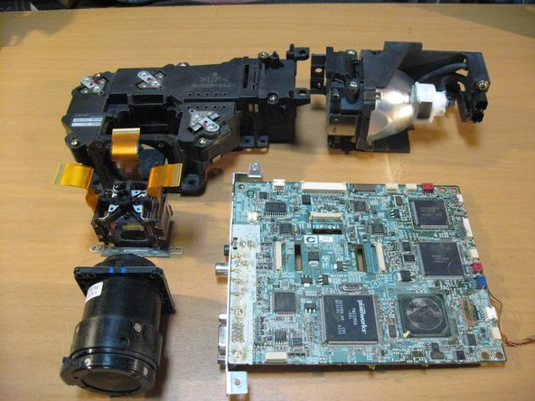 A shot of the LCD Assembly, Lens, Lamp and Mainboard.