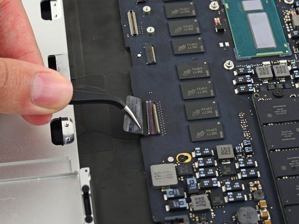 Pull the keyboard cable straight out of its ZIF socket on the logic board.