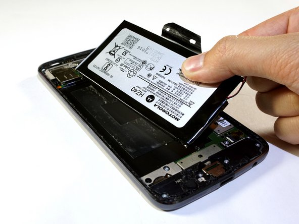 Lift to remove the battery from the device completely.