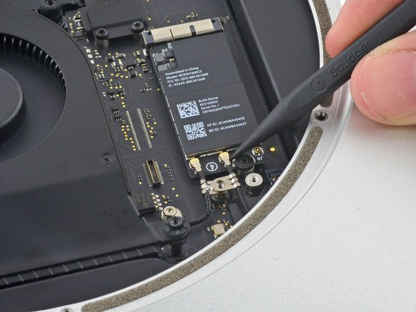 Use the point of a spudger to lift the antenna connectors up off their sockets.