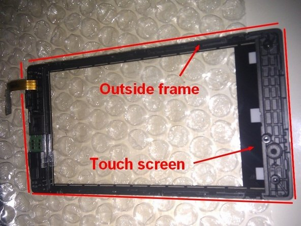 The outside frame is glued around the edges to the touch screen. Carefully separate the two pieces using the Cutter Blade.