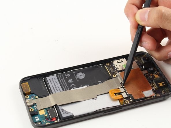 Using a spudger, disconnect the battery ribbon cable from the motherboard.