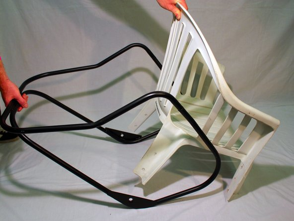Fit the lawn chair with the main frame,  aligning the back of the lawn chair with the main frame.