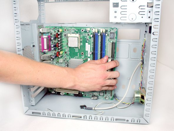Remove the motherboard by pushing it forwards and removing it from the case.