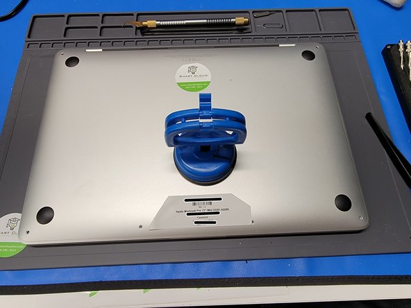 After the screws are removed, grab a suction cup. We used iFixit's Heavy Duty Suction cup.