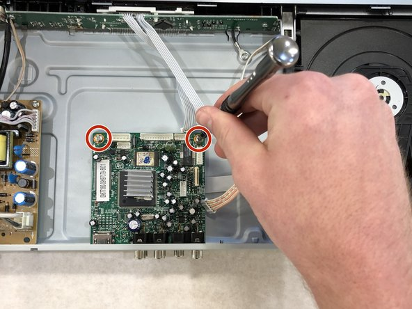 Remove the two 7.94 mm #1 Phillips head screws from the motherboard.