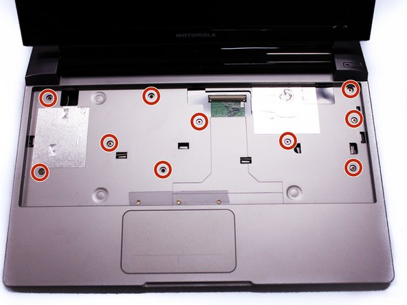 After we remove the Keyboard, you can clearly see the screws under it. Remove the ten 3mm long phillips head screws.